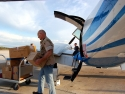 An All-volunteer Group Helps Load Supplies Into The Airplanes Each Morning.