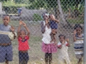 Les Cayes Haiti. Haitian Children I Met Outside The Airport Boundary Fence Where My Airplane Is Being Unloaded. Look Closely At The Eyes. Tonight I'm Buying Some Toys And Candy Bars To Throw Over The Fence For Them For Tomorrow's Trip.
