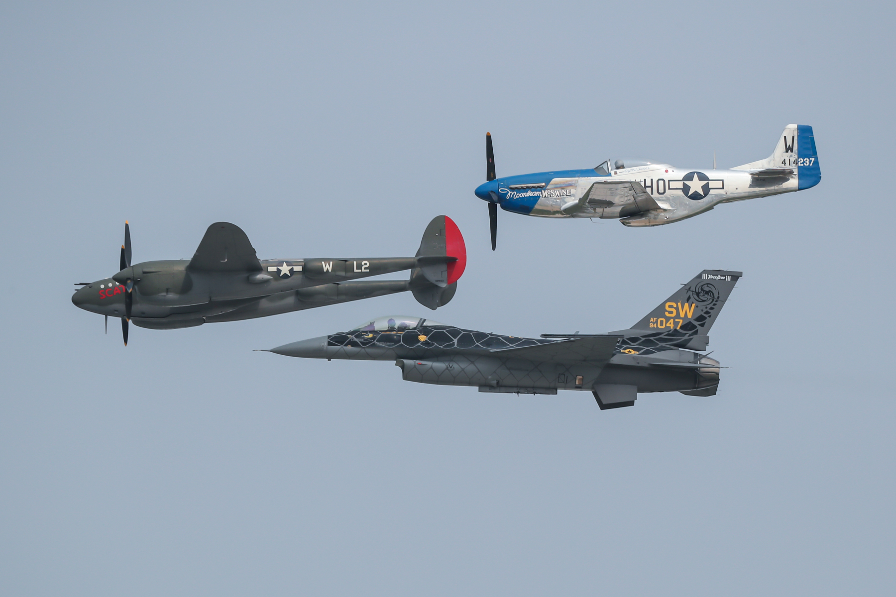 Lockheed P-38 Lightning, North American P-51 Mustang, and General Dynamics F-17 Fighting Falcon by Art Eichmann